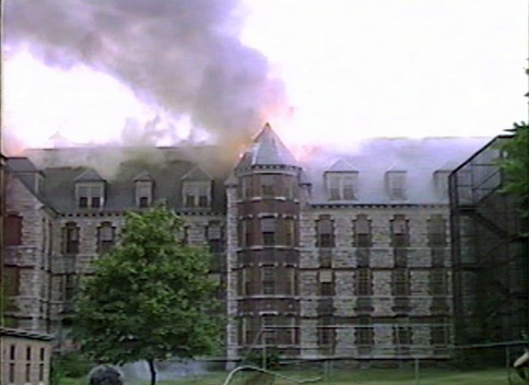 A wing of the Worcester State Hospital Kirkbride building burns